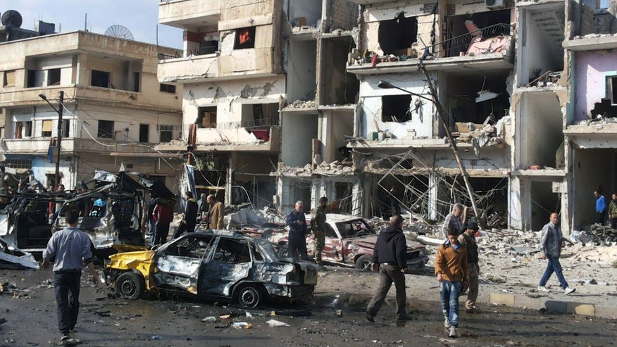Two blasts in the central Syrian city of Homs killed more than a dozen people and injured many others.