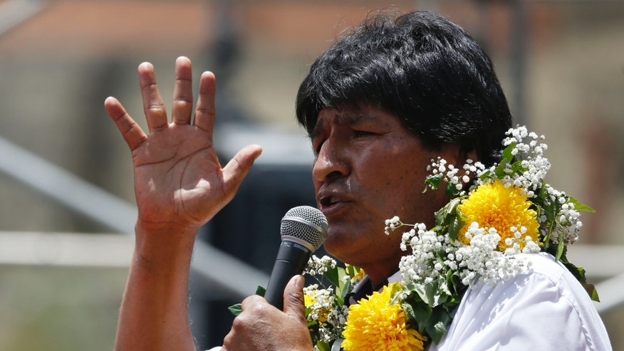 "Bolivia's President Evo Morales speaks during the the ""Yes"" closing campaign rally, in El Alto, Bolivia, Wednesday, Feb. 17, 2016. Bolivians go to the polls Sunday to vote on a  referendum, that if approved, would allow Morales to run for a fourth consecutive term. (AP Photo/Juan Karita)"