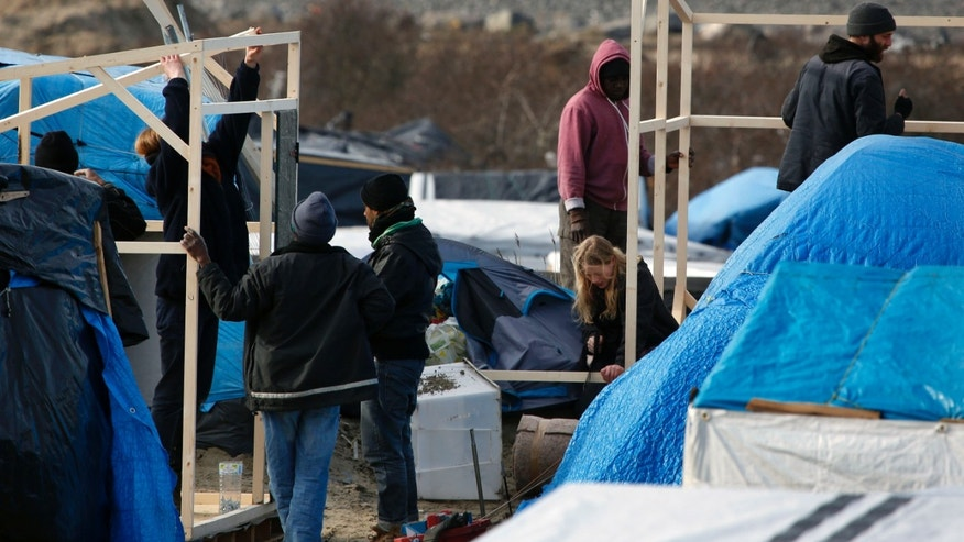 "A makeshift camp for migrants near Calais, France. A French court approved razing tents at a camp known as the ""jungle."""