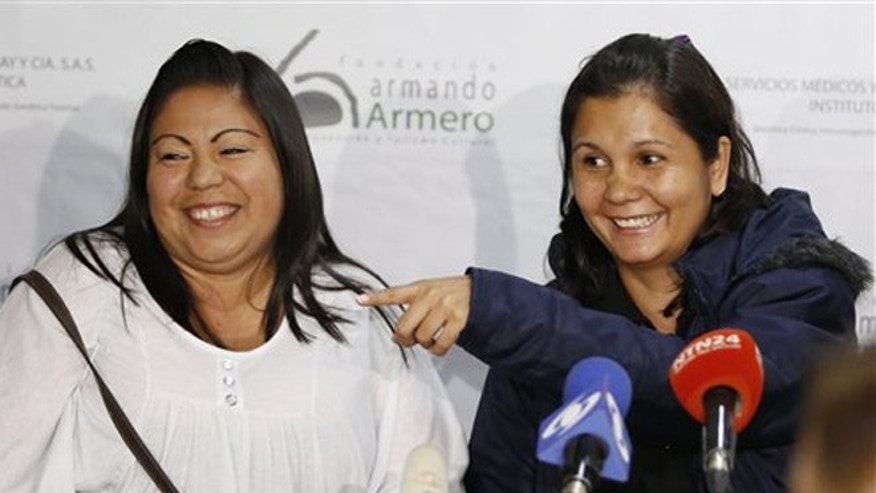 Feb. 25, 2016: Jacqueline Vasquez Sanchez, left, and her sister Lorena Sanchez, right, smile during a press conference in Bogota, Colombia.