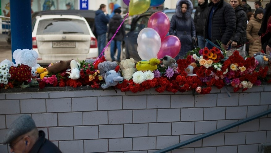 March 1, 2016: Flowers, children's toys and balloons are seen outside a subway station in Moscow, Russia.