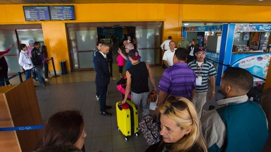 Passengers enter the charter departures at Jose Marti International Airport in Havana, Cuba.