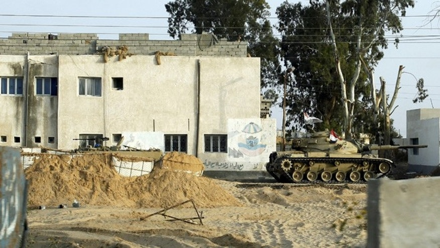 May 25, 2015: An Egyptian army tank is seen stationed outside a school taken over by soldiers in the Sinai Peninsula.