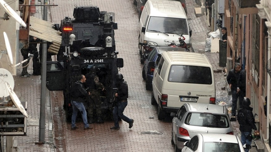 March 3, 2016: Security forces take position during an operation against two attackers, in Istanbul.