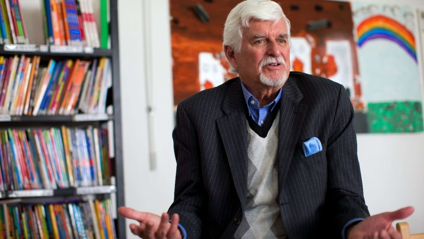 In this picture taken Thursday, Feb. 25, 2016, Thomas Webber speaks to The Associated Press in the library of the Lycée Français Charles de Gaulle school in Damascus, Syria.