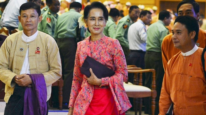 Feb. 1, 2016: Burma opposition leader Aung San Suu Kyi, center, walks along with other lawmakers of her National League for Democracy party as they leave after a regular session of the lower house of parliament in Naypyitaw, Burma.