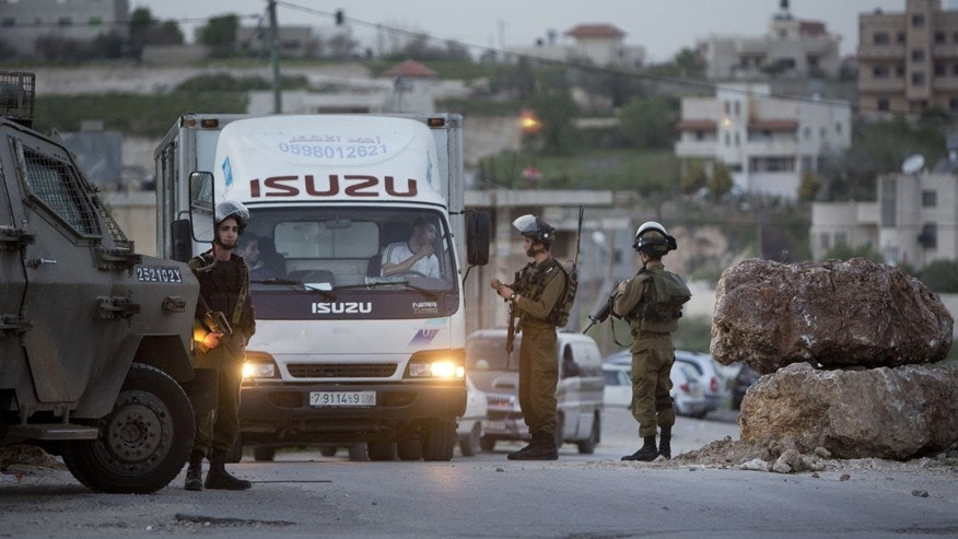 March 9, 2016: Israeli soldiers check Palestinians at a checkpoint on the road to the village of Hajja near the West Bank city of Nablus.