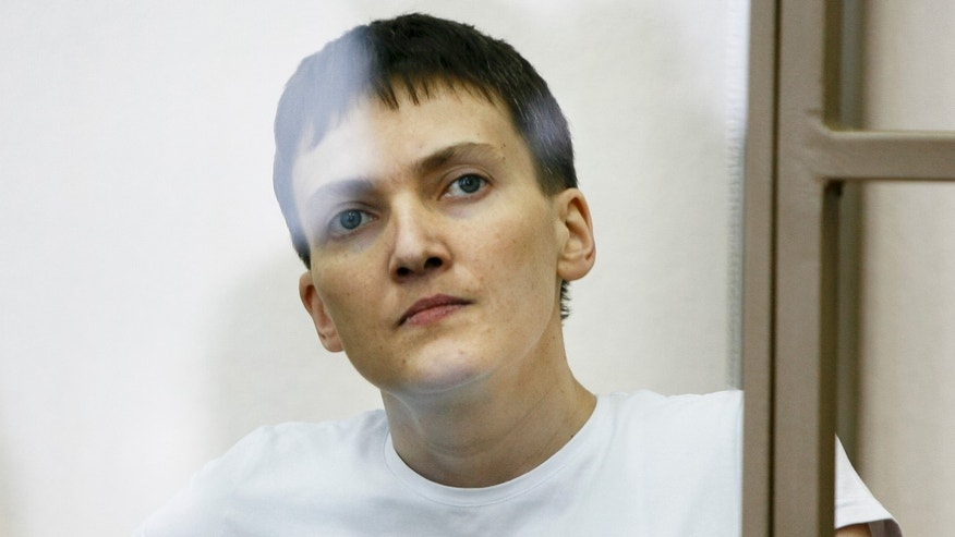 Nadezhda Savchenko sits in a glass cage during her trial Wednesday.