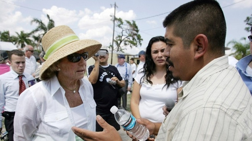 "Immokalee, UNITED STATES:  Ethel Kennedy (L), widow of Robert F. Kennedy, listens to Lucas Benitez, a leader of the Coalition of Immokalee Workers (CIW), as she and others toured a large migrant farmworker community in their first stop of the ""Robert F. Kennedy Memorial Poverty Tour: A Journey for Economic and Social Justice"" in Immokalee, 150km (90 miles) northwest of Miami, 23 April 2006. The CIW is currently fighting with large food corporations for a raise in wages and workers rights who currently gain depressed worker wages and lack basic health insurance and other basic labor rights. About seventy five percent of the workers are immigrants from Mexico and Guatemala.    AFP PHOTO/Roberto SCHMIDT  (Photo credit should read ROBERTO SCHMIDT/AFP/Getty Images)"
