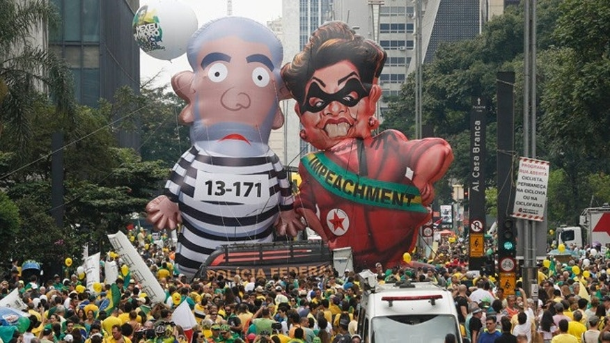 Demonstrators parade in Sao Paulo, Brazil, Sunday, March 13, 2016.
