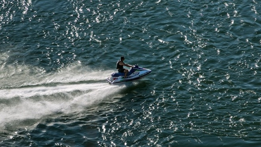 "REDDING, CA - JULY 19:  A man on a jet ski rides up the Sacramento River as viewed on July 19, 2015, in Redding, California. After entering the fourth year of drought, reservoirs continue to flucuate at low levels, Governor Jerry ""Edmund"" Brown has declared a ""mandatory reduction"" on water useage for all of California. (Photo by George Rose/Getty Images)"