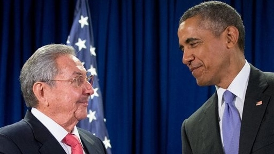 FILE - In this Sept. 29, 2015 file photo, President Barack Obama stands with Cuba's President Raul Castro before a bilateral meeting at the United Nations headquarters. President Barack Obama will use his historic trip to Cuba to chip away at key remaining U.S. obstacles to travel and commerce with the communist island, working to push his rapprochement past the point of no return before he leaves office. (AP Photo/Andrew Harnik, File)