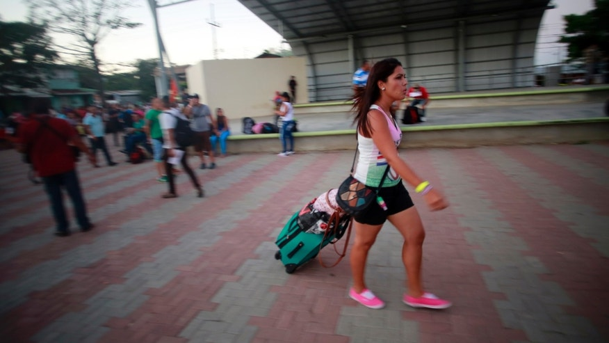 A Cuban migrant walks to the airport in La Cruz, Costa Rica, Tuesday, Jan. 12, 2016.