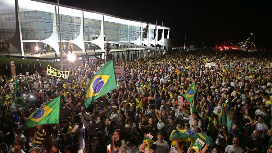 March 16, 2016: Demonstrators call for the impeachment of Brazil's President Dilma Rousseff and protest the naming of her mentor, former President Luiz Inacio Lula da Silva, as her new chief of staff, outside Planalto presidential palace in Brasilia, Brazil.