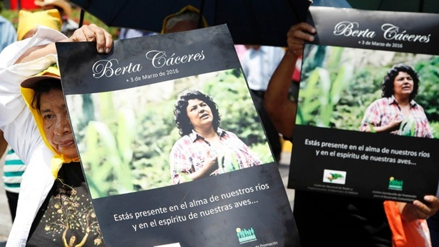 Women hold up posters with a photo of slain environmental leader Berta Caceres during a protest march in Tegucigalpa, Honduras, Wednesday, March 16, 2016. Authorities said that unidentified gunmen killed Nelson Garcia, a colleague of Caceres, who was slain almost two weeks ago in similar circumstances. The organization that both Caceres and Garcia belonged to is describing Garciaâs death as part of âthe governmentâs constant harassmentâ of Indian groups. Both activists were Lenca Indians and belonged to the Indian Council of People's Organizations of Honduras. (AP Photo/Fernando Antonio)