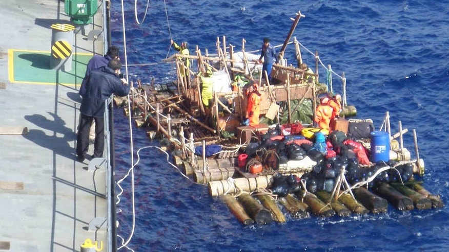 In this Thursday, March 17, 2016 photo, provided by the Chilean Navy, of the one of two rafts of the Kon-Tiki 2 expedition is rescued by a Chilean Navy ship, about 994 miles west of Puerto Montt in southern Chile.