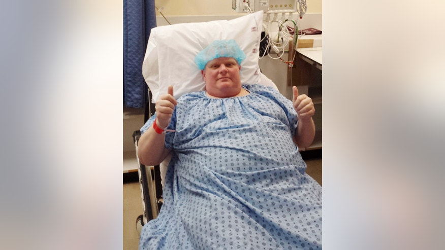 FILE - In this Monday, May 11, 2015 photo provided by Dan Jacobs, former Toronto Mayor Rob Ford gives a thumbs up before surgery in Toronto, to remove a cancerous tumor from his abdomen.