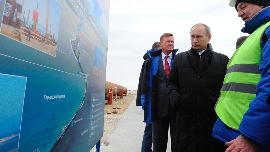 March 18, 2016: Russian President Vladimir Putin, center, visits the construction site of the Kerch Strait bridge on the Tuzla Island.