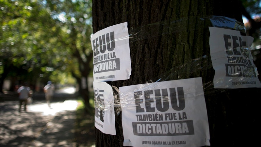 "Leaflets that read in Spanish ""The U.S. was also the dictatorship, Obama out of former Argentine Navy School of Mechanics"" hang on a tree at the Space for Memory and for the Promotion and Defense of Human Rights, in Buenos Aires, Argentina, Wednesday, March 16, 2016. U.S. President Barack Obama will move to declassify U.S. military and intelligence records related to Argentina's ""Dirty War,"" the White House said Thursday, March 17, aiming to bring closure to questions of U.S. involvement in a notorious chapter in Argentina's history. The Argentine Navy School of Mechanics was used by the military government as a torture and killing center during the military dictatorship and is now a center for the remembrance of the victims and the promotion and defense of human rights. (AP Photo/Natacha Pisarenko)"