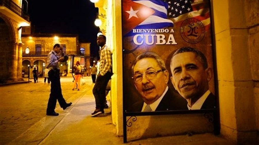 "A poster features portraits of Cuba's President Raul Castro, left, and U.S. President Barack Obama and reads in Spanish ""Welcome to Cuba"" outside a restaurant in Havana, Cuba, Thursday, March 17, 2016. Obama is scheduled to travel to the island on March 20, the first U.S. presidential trip to Havana in nearly 90 years. (AP Photo/Ramon Espinosa)"