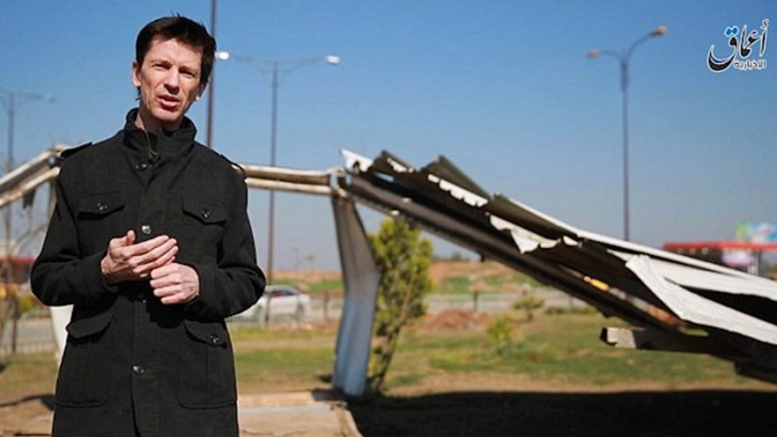 This photo posted online by the Islamic State group-affiliated Amaq News Agency on Friday, March 18, 2016 shows British journalist John Cantlie, who is being held hostage by the militants, during a stand-up for an IS propaganda video in Mosul, Iraq.