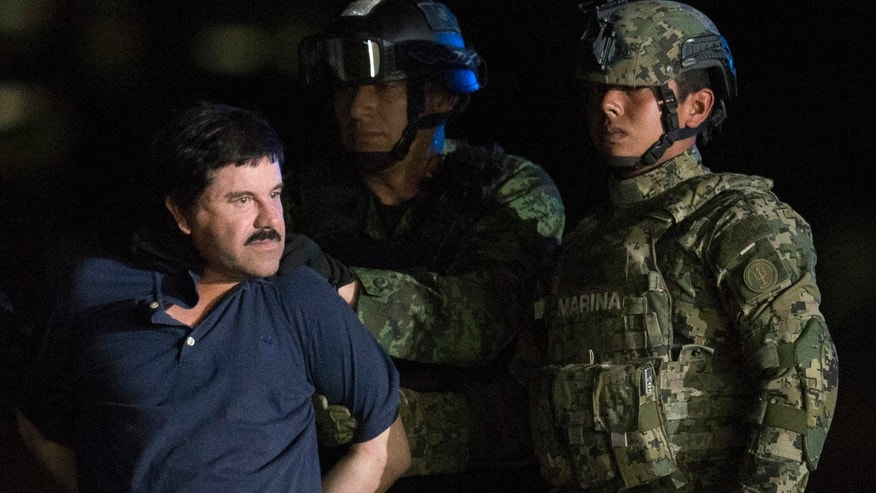 "FILE - In this Jan. 8, 2016, file photo, Mexican drug lord Joaquin ""El Chapo"" Guzman is escorted by army soldiers to a waiting helicopter, at a federal hangar in Mexico City."