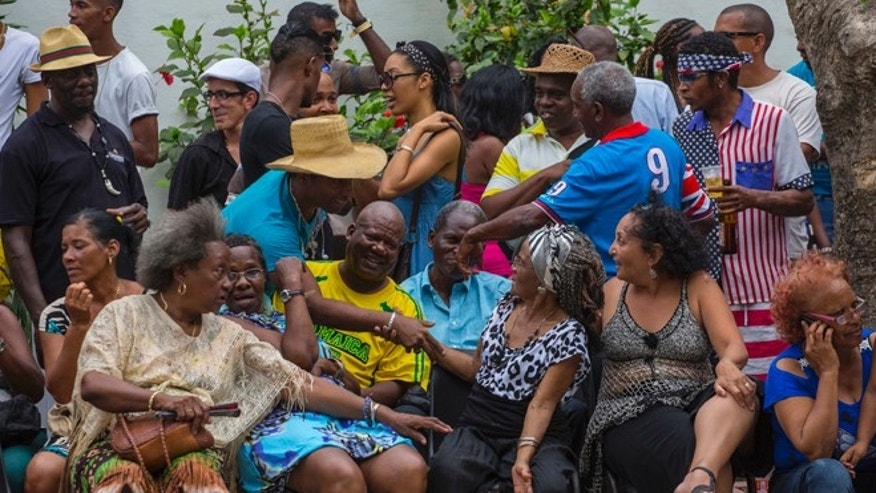 Afro-Cubans take part in a weekly rumba dance gathering in Havana, Saturday, March 19, 2016.