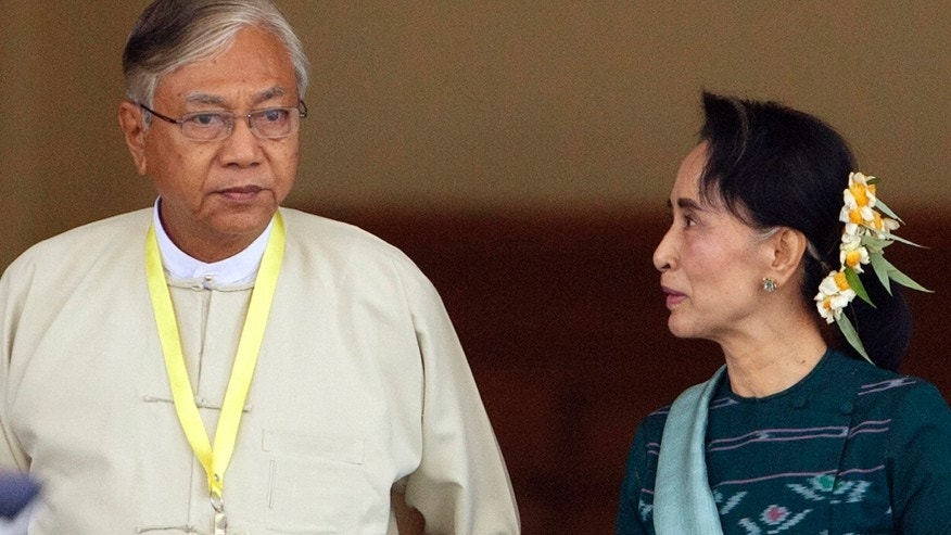 March 15, 2016: Htin Kyaw, left, newly elected president of Burma, walks with National League for Democracy leader Aung San Suu Kyi, right, at Burma's parliament in Naypyitaw, Burma.