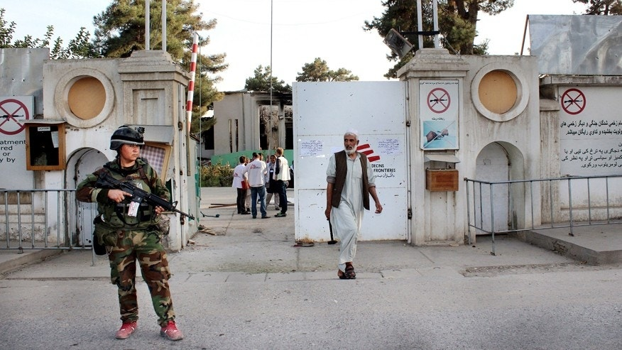 Oct. 15, 2015: An Afghan National Army soldier stands guard at the gate of a Doctors Without Borders hospital in Kunduz, Afghanistan