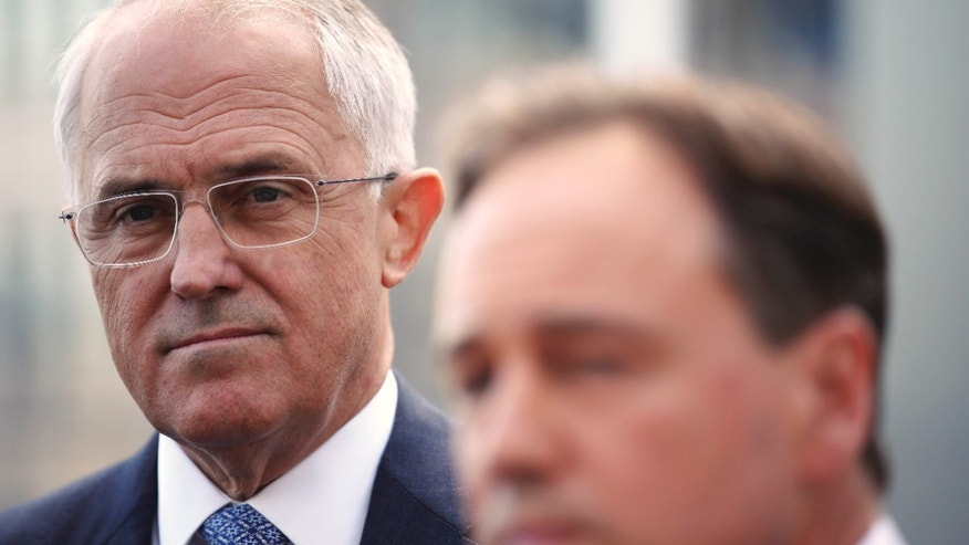 March 23, 2016: Australian Prime Minister Malcolm Turnbull, left, listens to Minister for the Environment Greg Hunt, as they attend a press conference in Sydney.