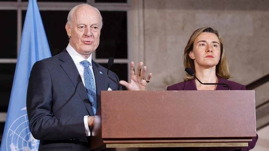 UN Special Envoy of the Secretary-General for Syria Staffan de Mistura, left, next to European Union Foreign Policy Chief Federica Mogherini, speaks to the media during a press conference a bilateral meeting about the Syrian Crisis, at the European headquarters of the United Nations in Geneva, Switzerland, Wednesday, March 23, 2016. (Salvatore Di Nolfi/Keystone via AP)