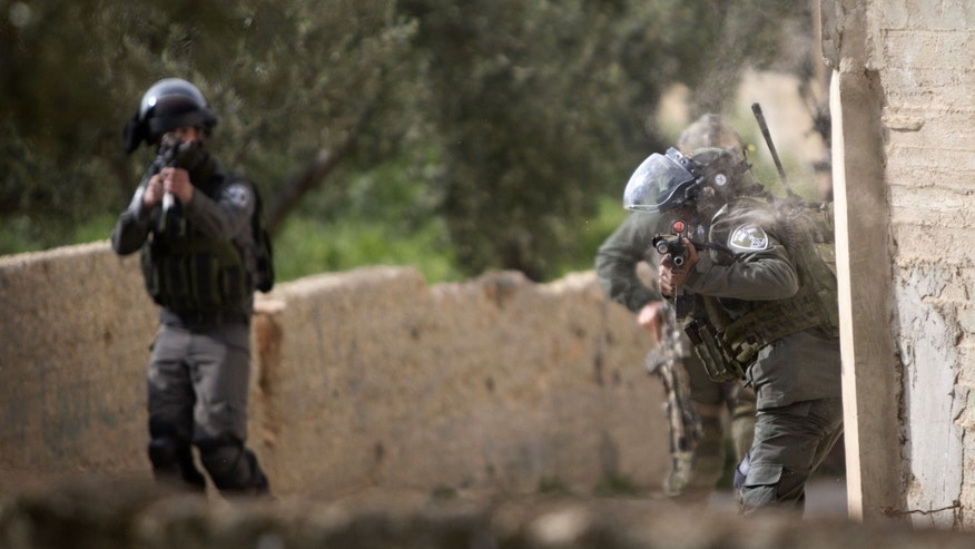 Israeli border police officers in the Palestinian village of Duma near the West Bank on Sunday.