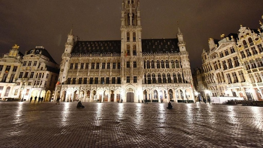 The Belgian landmark Grand Place in Brussels is empty on Wednesday evening, March 23, 2016.  Bombs exploded yesterday at the Brussels airport and one of the city's metro stations, killing and wounding scores of people, as a European capital was again locked down amid heightened security threats. (AP Photo/Martin Meissner)