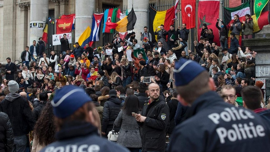 Belgian police patrols as people gathered to mourn for the victims of the bombings at the Place de la Bourse in the center of Brussels, Belgium, Thursday, March 24, 2016. The Islamic State group has trained at least 400 fighters to target Europe in deadly waves of attacks, deploying interlocking terror cells like the ones that struck Brussels and Paris with orders to choose the time, place and method for maximum carnage. (AP Photo/Peter Dejong)