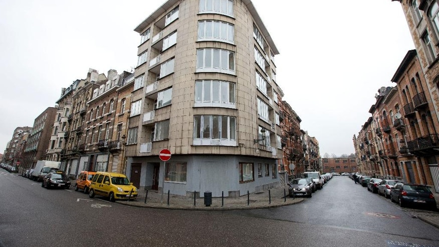 The apartment complex which was raided by police on Tuesday night after twin bomb attacks, center, is seen in Brussels, Belgium, Wednesday, March 23, 2016. Belgian state media reports that the police confirmed that two brothers Khalid en Ibrahim El Bakraoui were involved in the deadly suicide attacks on the Brussels airport and its subway system. (AP Photo/Peter Dejong)