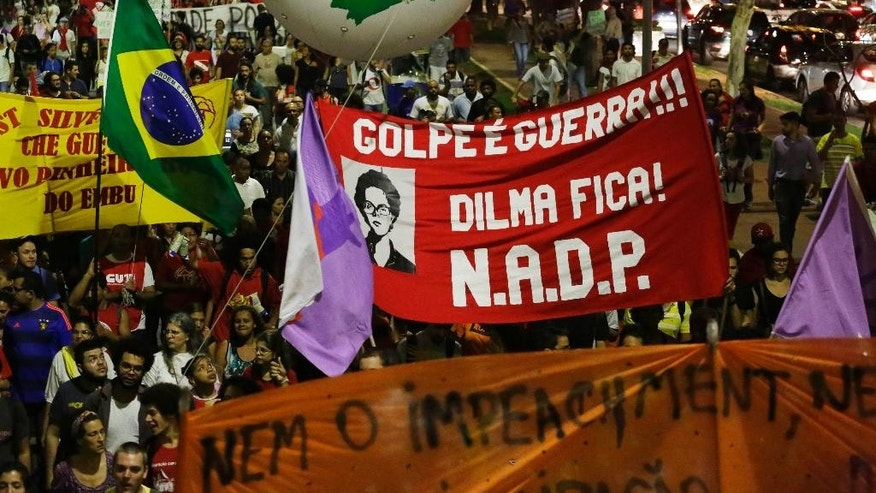 Demonstrators protest against efforts to impeach Brazil's President Dilma Rousseff and in support of former President Luiz Inacio Lula da Silva in Sao Paulo, Brazil, Thursday, March 24, 2016. (AP Photo/Nelson Antoine)
