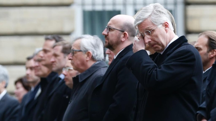 "Belgium's King Philippe, right, wipes his eyes as he stands next to Belgium's Prime Minister Charles Michel during a service in grounds of the Parliament building, in memory of the victims of the recent attacks in Belgium, Thursday, March, 24, 2016. Belgium's prime minister is promising to do everything to determine who was responsible for deadly attacks targeting the Brussels airport and subway system. Charles Michel, in a national mourning speech Thursday, said Tuesday's attacks on the European Union's capital targeted the ""liberty of daily life"" and ""the liberty upon which the European project was built."" (AP Photo/Alastair Grant)"