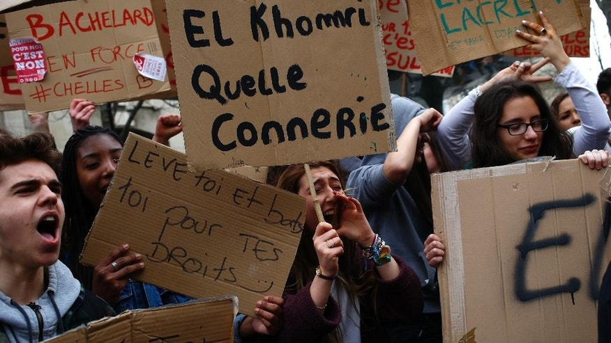 High school students march during a demonstration against a labor reform, in Paris, Thursday, March 24, 2016. France's Socialist government is due to formally present a contested labor reform that aims to amend the 35-hour workweek and relax other labor rules. Poster reads: El Khomri, what stupidity. Myriam el Khomri is the French Labor minister. (AP Photo/Francois Mori)