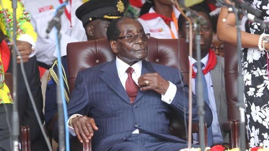 "Zimbabwean President Robert Mugabe is seen during commemorations to mark his 92nd Birthday celebrations in this Saturday, Feb. 27, 2016 photo.  Poking fun at Mugabe is a risky business which has a law that forbids ""undermining the authority of or insulting the president"".  Primary school headmaster Edson Chuwe faces a year in prison if convicted because his spoof image of Mugabe posing with singer Rihanna is not seen as funny, according to prosecutors, and a printed screen shot of the image is now a key peace of evidence in the trial against the headmaster who posted it on Facebook.(AP Photo/Tsvangirayi Mukwazhi)"