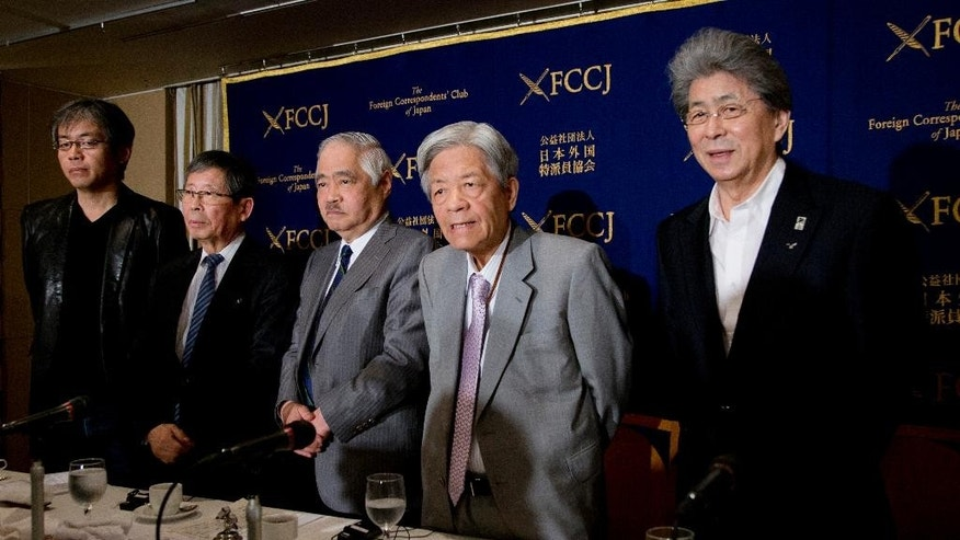 Japanese journalists, from left, Osamu Aoki, Akihiro Otani, Shigetada Kishii, Soichiro Tahara and Shuntaro Torigoe, pose for a photo before their press conference at Foreign Correspondents' Club of Japan in Tokyo, Thursday, March 24, 2016. A group of five journalists accused Prime Minister Shinzo Abe's government Thursday of pressuring broadcasters to reduce criticism of its policies, but also lamented what they called a failure by the media to live up to its convictions. (AP Photo/Shuji Kajiyama)