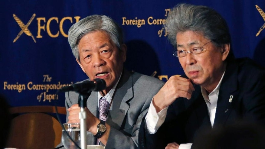Journalists, Soichiro Tahara, left, and Shuntaro Torigoe, attend a press conference at Foreign Correspondents' Club of Japan in Tokyo, Thursday, March 24, 2016. Tahara, Torigoe and three other Japanese journalists accused Prime Minister Shinzo Abe's government Thursday of pressuring broadcasters to reduce criticism of its policies, but also lamented what they called a failure by the media to live up to its convictions. They spoke at the news conference after the minister of communications warned broadcasters last month that their licenses could be revoked if they fail to be impartial in political coverage. (AP Photo/Shuji Kajiyama)