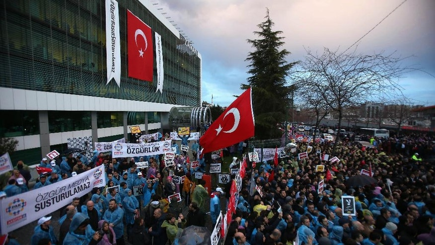 FOR STORY TURKEY MEDIA UNDER SIEGE - FILE - In this March 4, 2016 file photo, some thousands of people gather in solidarity outside Zaman newspaper offices in Istanbul after a local court ordered that Turkey's largest-circulation, opposition newspaper be placed under the management of trustees. Turkey's most defiantly government-critical newspaper has, almost overnight, turned into a pro-government publication joining scores of other media outlets that toe the government's line, while two prominent opposition journalists go on trial in Turkey, facing life imprisonment for their reports.(AP Photo/Emrah Gurel, FILE)