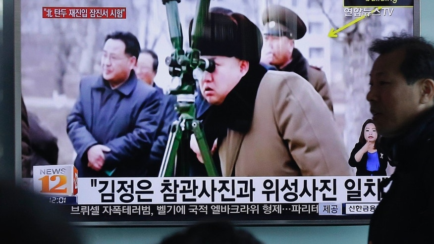 March 24, 2016: A man passes by a TV screen showing North Korean leader Kim Jong Un during a news program at Seoul Railway Station in Seoul, South Korea.