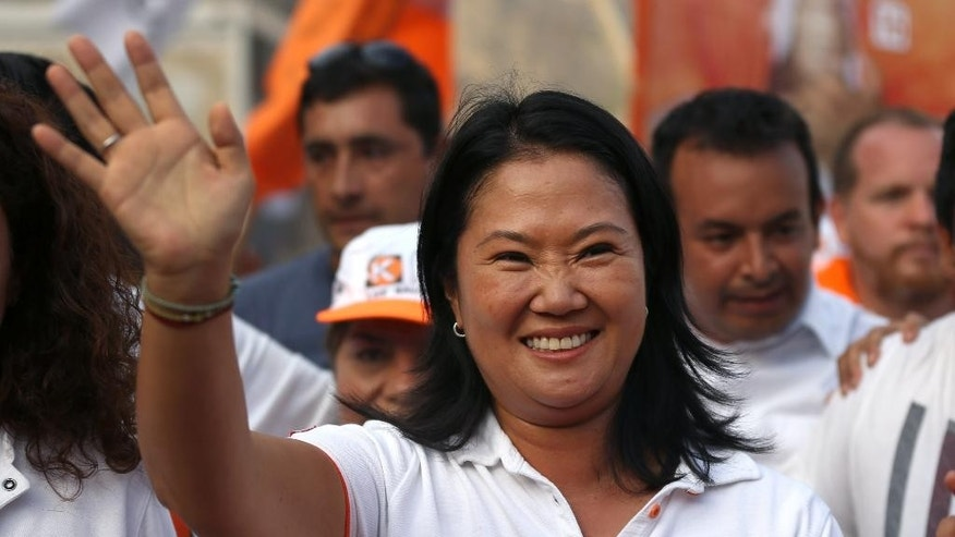 "Presidential candidate Keiko Fujimori, of the ""Fuerza Popular"" political party, waves to supporters as she campaigns in San Juan de Lurigancho shantytown on the outskirts of Lima, Peru, Tuesday, March 22, 2016. Keiko, the daughter of former President Alberto Fujimori, is running for president in Peru's April 10 election. (AP Photo/Martin Mejia)"