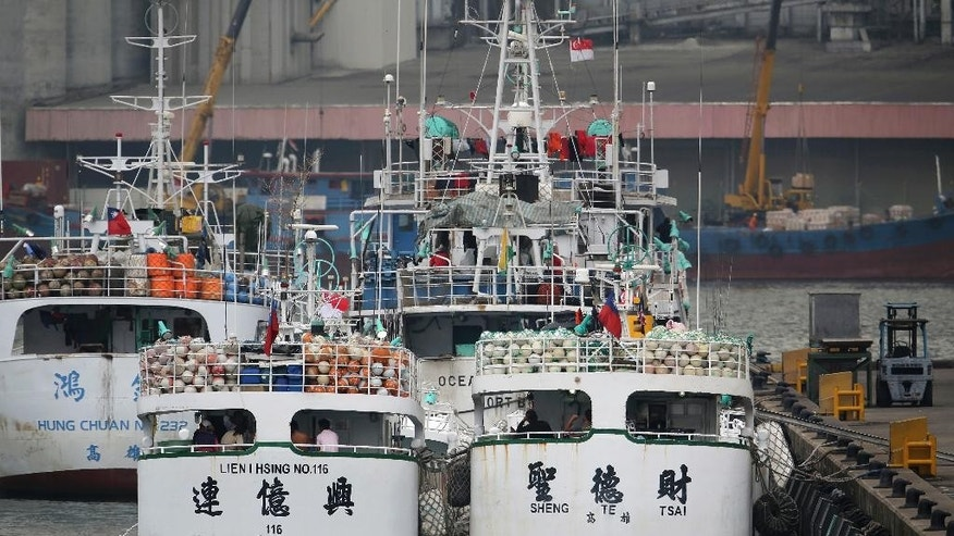 Two tuna longliners, Lien I Hsing No. 116 and Sheng Te Tsai, whose home port is in southern Taiwan, are docked at the Jurong Fishery Port in Singapore Thursday, March 24, 2016. Taiwan has demanded an explanation from Indonesia after the two Taiwanese fishing boats were allegedly fired on by an Indonesian government vessel near the Strait of Malacca. (AP Photo/Wong Maye-E)