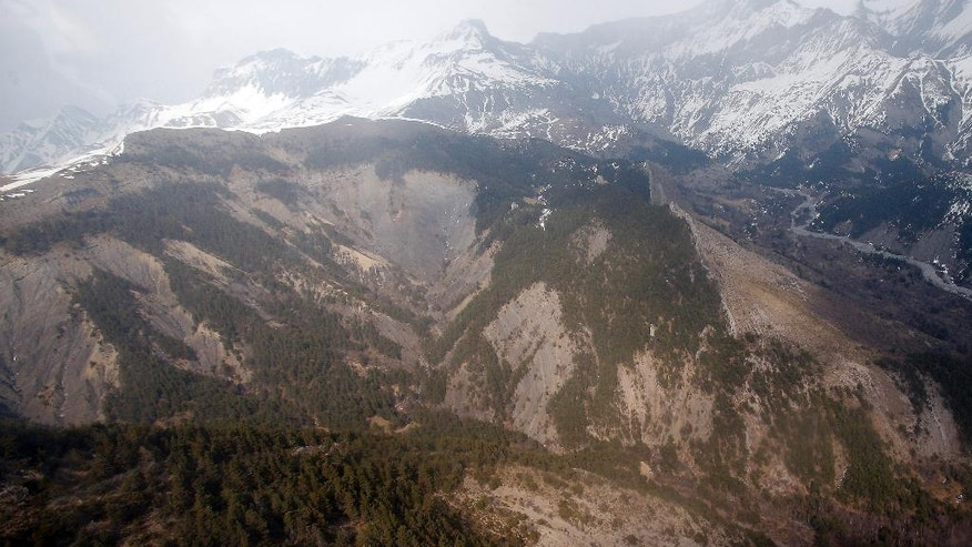 View of the Germanwings plane crash site near Seyne-les-Alpes, Wednesday, March 23, 2016. The families of the 150 passengers and crew killed in the March 24, 2015, crash are to attend on Thursday March 24, a ceremony marking one year after the plane crash, in Le Vernet, French Alps. (AP Photo/Christophe Ena)
