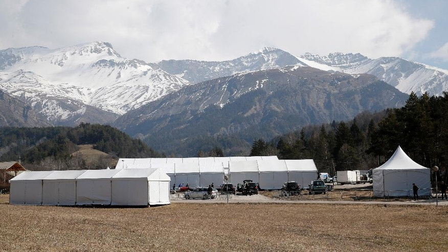 Tents are set up on the eve of ceremonies marking one year after the Germanwings plane crash, Wednesday, March 23, 2016 in Le Vernet, in the French Alps. The families of the 150 passengers and crew killed in the March 24, 2015, crash are to attend a ceremony in Le Vernet.  (AP Photo/Christophe Ena)