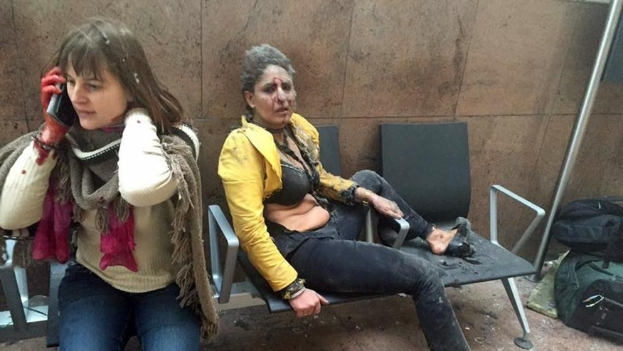 FILE - This Tuesday, March 22, 2016, file photo provided by Georgian Public Broadcaster and photographed by Ketevan Kardava shows Nidhi Chaphekar, right, a 40-year-old Jet Airways flight attendant from Mumbai, and another unidentified woman after being wounded in Brussels Airport in Brussels, Belgium, after explosions were heard. The Indian flight attendant who was injured in the Brussels airport blasts is in stable condition and recovering, her airline Jet Airways said Friday, March 25, 2016. Chaphekar suffered burns and fractured her foot in the explosions on Tuesday. She has been treated at a hospital near Brussels. (Ketevan Kardava/Georgian Public Broadcaster via AP, File)