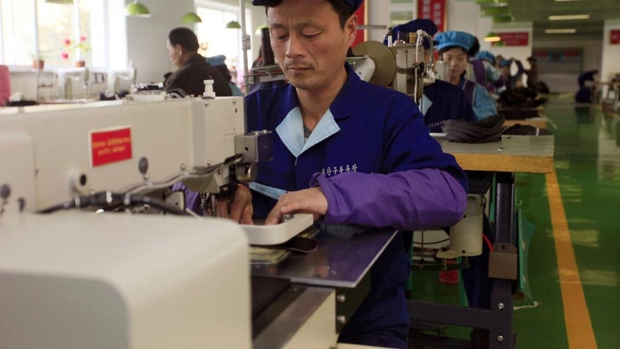 "In this Monday, March 14, 2016 photo, workers use machines to make shoes at Wonsan Shoes Factory in the 70-day campaign in Wonsan, Kangwon Province, North Korea. North Koreans are being mobilized en masse to boost production and demonstrate their loyalty to leader Kim Jong Un in a 70-day campaign aimed at wiping out ""indolence and slackness."" To show their loyalty, workers are putting in extra hours to boost production in everything from coal mining to fisheries. (AP Photo/Kim Kwang Hyon)"