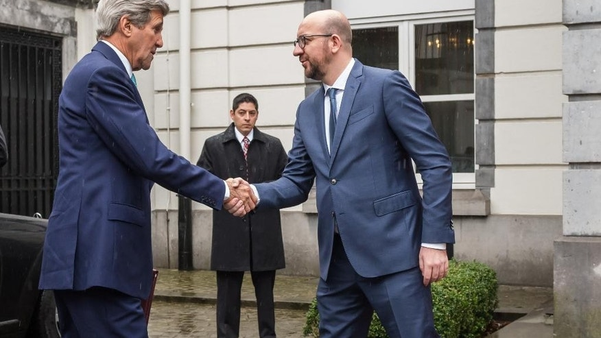Belgium's Prime Minister Charles Michel, right, welcomes U.S. Secretary of State John Kerry upon his arrival at the Prime Minister's residence in Brussels, Belgium, Friday, March 25, 2016. Kerry is in Brussels to pay respect to victims of terrorist attacks that left a number dead earlier this week. (AP Photo/Geert Vanden Wijngaert)